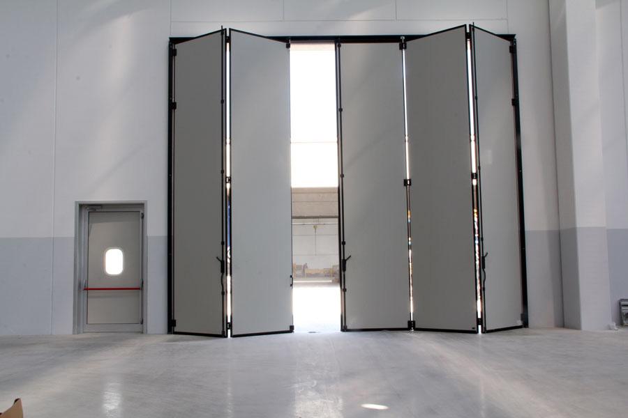 Portoni a libro porte rapide saliscendi bellei rappresentanze industriali modena italy - Porte scorrevoli a pacchetto ...